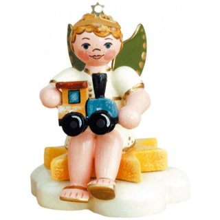 Hubrig angel boy with locomotive - sitting