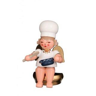 Christian Ulbricht baker angel with stirring spoon sitting